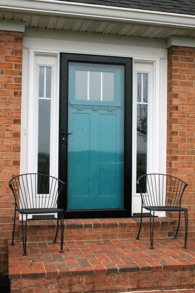 Charmant I Chose A Black Storm Door To Serve As A U201cframeu201d For My Door Coloru2013 My  Beloved Peacock Blue! And The Black Also Goes With The Shutters And Porch  Lights.